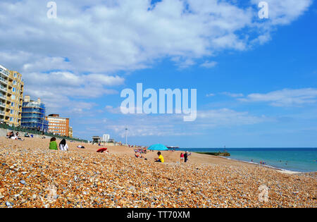 Brighton, UK - August 14, 2016: Beautiful panoramic view to pebble beach at the sea and the famous British Airways i360 observation tower at horizon. - Stock Photo