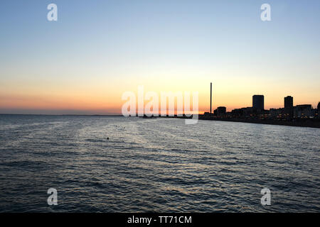 Beautiful panoramic cityscape of Brighton at sunset viewed from the sea. - Stock Photo