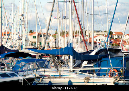 Vodice, Croatia - April 30, 2019: Sailing boats and fast boats anchored in marina in Adriaic sea - Stock Photo