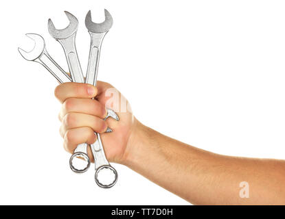 Metal wrenches in male hand isolated on white - Stock Photo