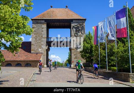 Cyclist at the German Wine Gate (german: Deutsches Weintor), beginning of the German Wine Route, Schweigen-Rechtenbach, Rhineland-Palatinate, Germany - Stock Photo