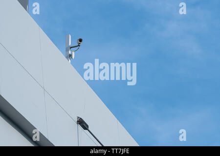 Security CCTV camera or surveillance system in office building - Stock Photo