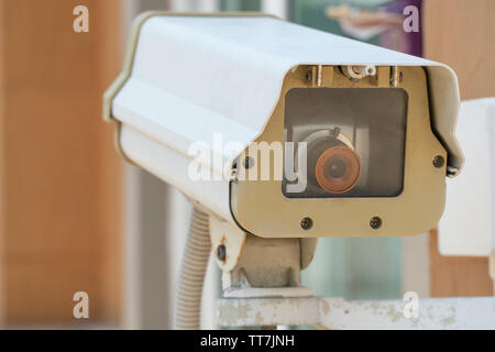 CCTV camera or outdoor security cameras on a wall, video protection safety system guard - Stock Photo