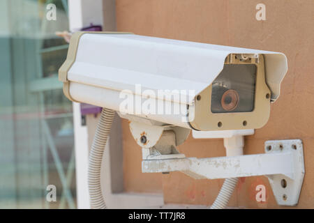Security CCTV camera or surveillance system on the wall, Private property protection - Stock Photo