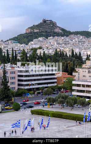 Athens, Attica / Greece. Athens city in Greece with Lycabettus Hill as seen from the vantage point of the Panathenaic Stadium (Kallimarmaron) - Stock Photo