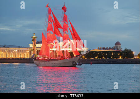 SAINT PETERSBURG, RUSSIA - JUNE 12, 2019: Brig Rossiya with scarlet sails during  the rehearsal of the holiday 'Scarlet sails' - Stock Photo