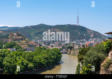 View across the River Mtkvari over the Old Town district towards the Tbilisi TV Tower on Mtatsminda mountain. Travel - Stock Photo