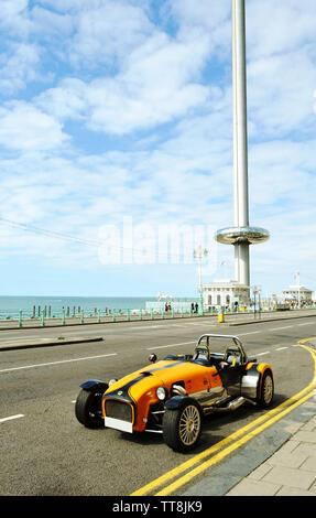 Brighton, UK - August 14, 2016: Beautiful yellow vintage Lotus Cobra car parked at the Brighton beach avenue near the British Airways i360 tower. - Stock Photo