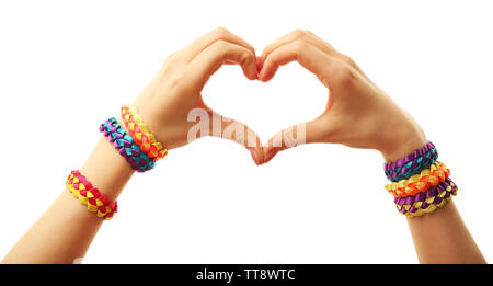 Female hands in shape of heart with bracelets isolated on white - Stock Photo