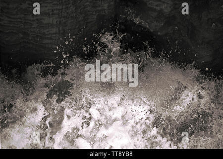 Water splash in black and white. Darkness ans shadow. Water in dynamic motion. Monochrome abstract background. Dynamism and energy concept. - Stock Photo