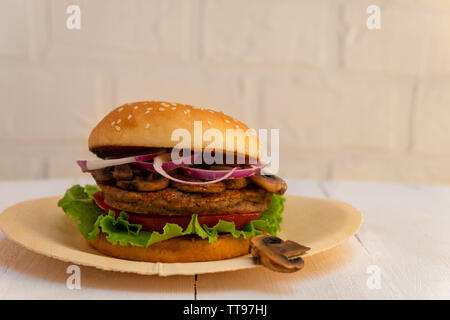 Vegan Mushroom and Bean Burger on white background with copy space. - Stock Photo