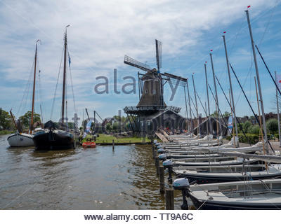 Woudsend, The Netherlands - July 27 2018: In the water sports village many sailing boats are ready for a sailing camp on the Frisian lakes. Large sail - Stock Photo
