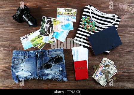 Set of travel things on wooden background - Stock Photo