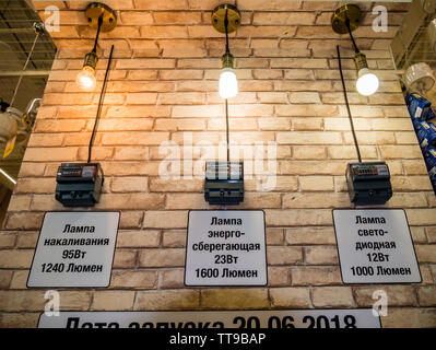 Voronezh, Russia - October 21, 2018: Comparison of power consumption of different types of light bulbs - Stock Photo