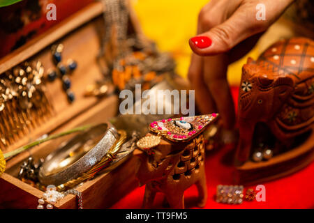 Cropped Hand decorationg Table with Jewellery