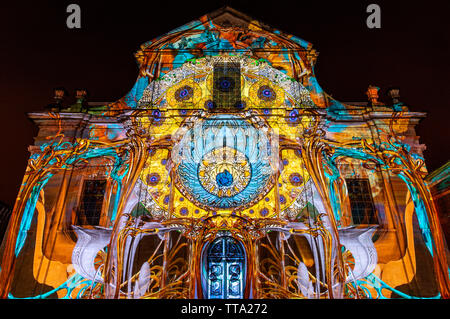 The baroque style facade of the Saint Peter's Abbey illuminated with colourful lights during the Ghent light festival (Gent in Flemish), Belgium. - Stock Photo