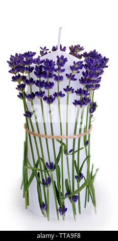 Candles with lavender flowers isolated on white - Stock Photo
