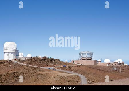 University of Hawaii observatories and the Maui space surveillance complex at the summit of Haleakala National Park, Maui - Stock Photo