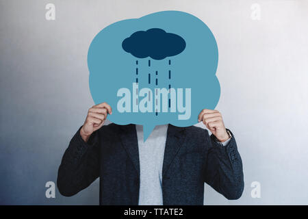 Customer Experience or Human Emotional Concept. Man Presenting his Unhappy Feeling by Drawn Line Cartoon Face on Speech Bubble Card - Stock Photo
