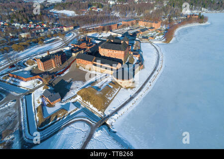 Above the ancient fortress of the  Hameenlinna city on a sunny March day (aerial photography). Finland - Stock Photo