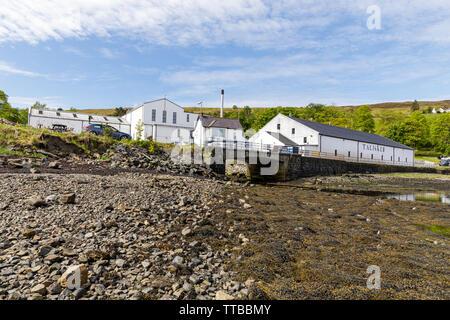 Talisker Distillery, a single malt Scotch whisky distillery, on the west coast of Skye by Loch Harport in Carbost on the Isle of Skye, Scotland, UK