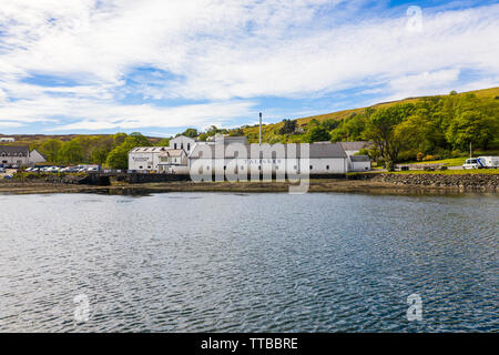 Aerial view of the Talisker Distillery, a single malt Scotch whisky distillery, on the west coast of Skye on the shores of Loch Harport in Carbost on