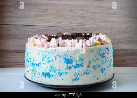 Large festive cake decorated with chocolate chips, marshmallows. Copy space for inscriptions. - Stock Photo