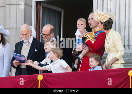 5 year old Prince George of Cambridge grabs the RAF flypast booklet from Prince Michael of Kent's hands.Buckingham Palace Balcony, Trooping the Colour - Stock Photo