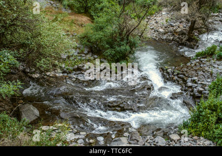 Bearing stones from the mountains,and calm in the summer heat of the river Azat, flows through the gorge Garni in Armenia - Stock Photo