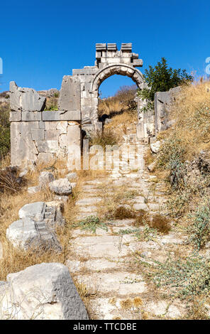 Turkey, located in the ancient city of Xanthos old stone gate to the city of Fethiye. - Stock Photo