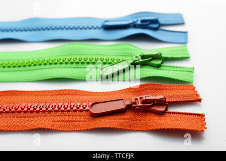 Colourful collection of zippers isolated on white - Stock Photo
