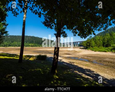 Dried lake-bed Bajer in Fuzine Croatia Spring 2019 highway bridge in background Stock Photo
