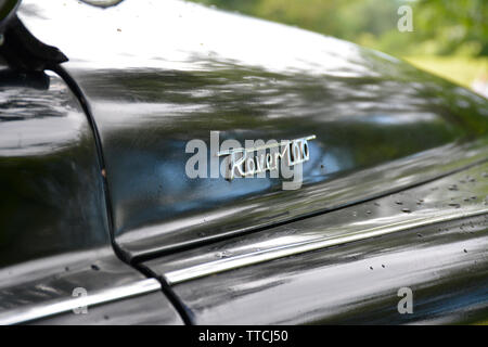 Close up of a Rover 100 Classic Car Showing the Chrome Badge on the Bonnet - Stock Photo