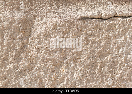 Ancient concrete wall with cement brown coating. A large crack in the upper left corner. Destruction of a worn building structure - Stock Photo