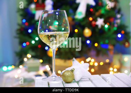 Glass of champagne on christmas decor background - Stock Photo