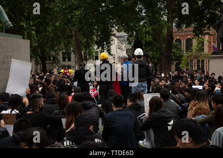 London, UK. 16th June 2019. Around 1000 demonstrators protest against the Extradition Law by the Hong Kong Government and its leader, Carrie Lam on Parliament Square, London, UK demanding British help in protecting freedom. The law would allow transfer of those suspected of crime, including political dissent, to be transferred to China. Credit: Joe Kuis / Alamy - Stock Photo