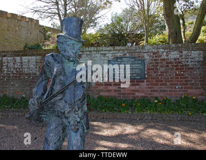 SIDMOUTH, DEVON - APRIL 1ST 2012: The statue of the Sidmouth Fiddler stands in Connaught gardens and commemorates 50 years of the annual folk week. It - Stock Photo