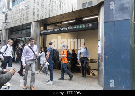 People on the sidewalk by the street entrance to the subway station at Grand Central Terminal along 42nd Street in Manhattan, NYC. - Stock Photo