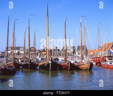 Traditional wooden fishing boats in harbour, Marken, Zaanstreek-Waterland, Noord-Holland, Kingdom of the Netherlands - Stock Photo