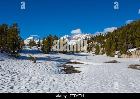 Snow capped mountain peaks in  Spring at Little lakes valley the Eastern Sierra Nevada mountains of California, USA - Stock Photo