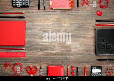 Frame of stationery on wooden background - Stock Photo