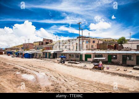 Uyuni, Bolivia- Dec 31, 2018: Houses in poor bolivian village between Uyuni and La Paz, Bolivia. Desert landscape of Bolivia. - Stock Photo