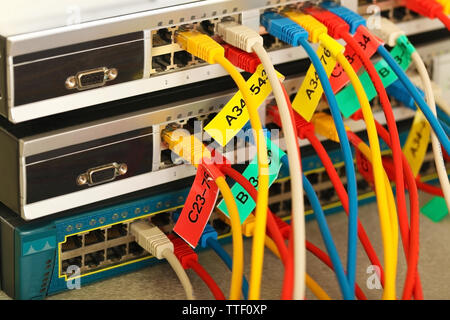 Ethernet cables connected to network switch, close up - Stock Photo