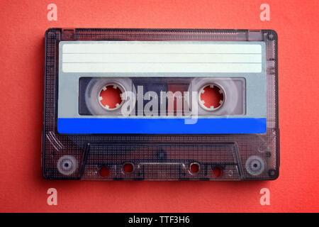 Old audio cassette on red background - Stock Photo