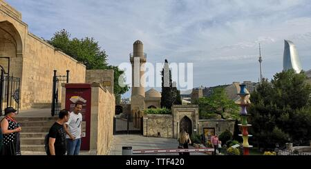 Mosque in Baku in front of the Flame Towers - Stock Photo