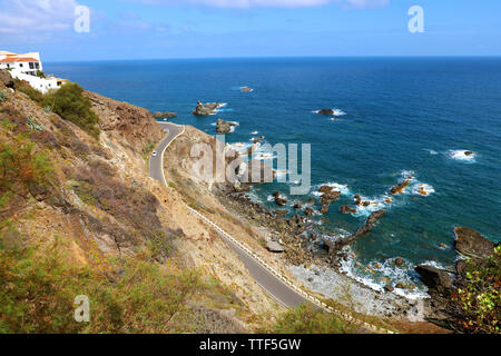 View from Almaciga of road that runs along Atlantic Ocean in Anaga mountain, Tenerife, Spain - Stock Photo
