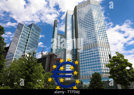 Business and finance concept with giant Euro sign at European Central Bank headquarters in the morning, business district in Frankfurt am Main, German - Stock Photo