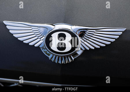 Monte-Carlo, Monaco - June 16 2019: Shining Bentley Winged 'B' Logo (Emblem) On The Bonnet Of A Luxury Black Car At Monte-Carlo, Monaco. Close Up View - Stock Photo