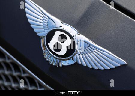 Monte-Carlo, Monaco - June 16 2019: Bentley Winged 'B' Logo (Emblem) On The Bonnet Of A Luxury British Black Car At Monte-Carlo, Monaco. Close Up View - Stock Photo