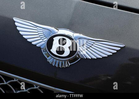Monte-Carlo, Monaco - June 16 2019: Famous Bentley Winged 'B' Logo (Emblem) On The Bonnet Of A Luxury Black Car At Monte-Carlo, Monaco. Close Up View - Stock Photo